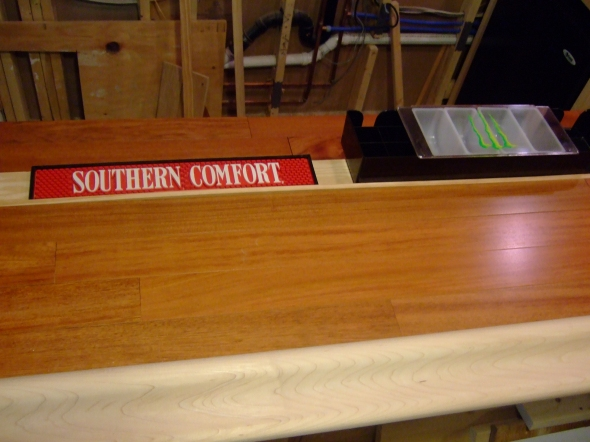 Southern Comfort in the Bar Rail