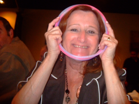 Pam is trying to fit through a very small hoop.