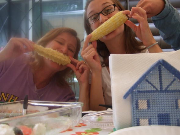 Maddie snapped this picture of a couple of whackos. With corn.